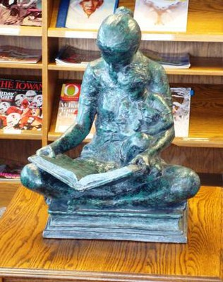 Bronze scuplture of a woman reading a book to a child