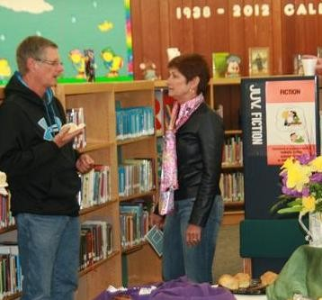 A man and woman chat during the 2012 Chamber Coffee event at the Library.
