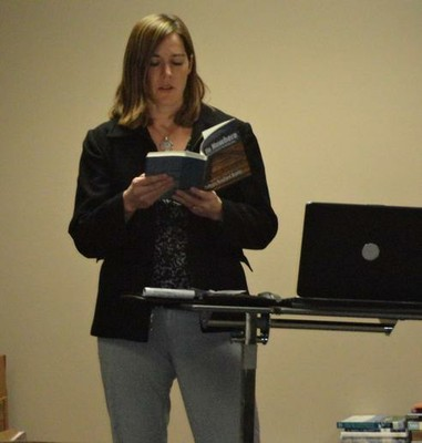 Colleen Bradford Krantz reading a book.
