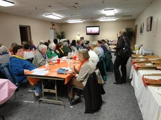 Friends of the Library members enjoy a luncheon.