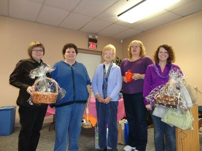 5 ladies, all Winter Reading Program winners, pose with their gift baskets.